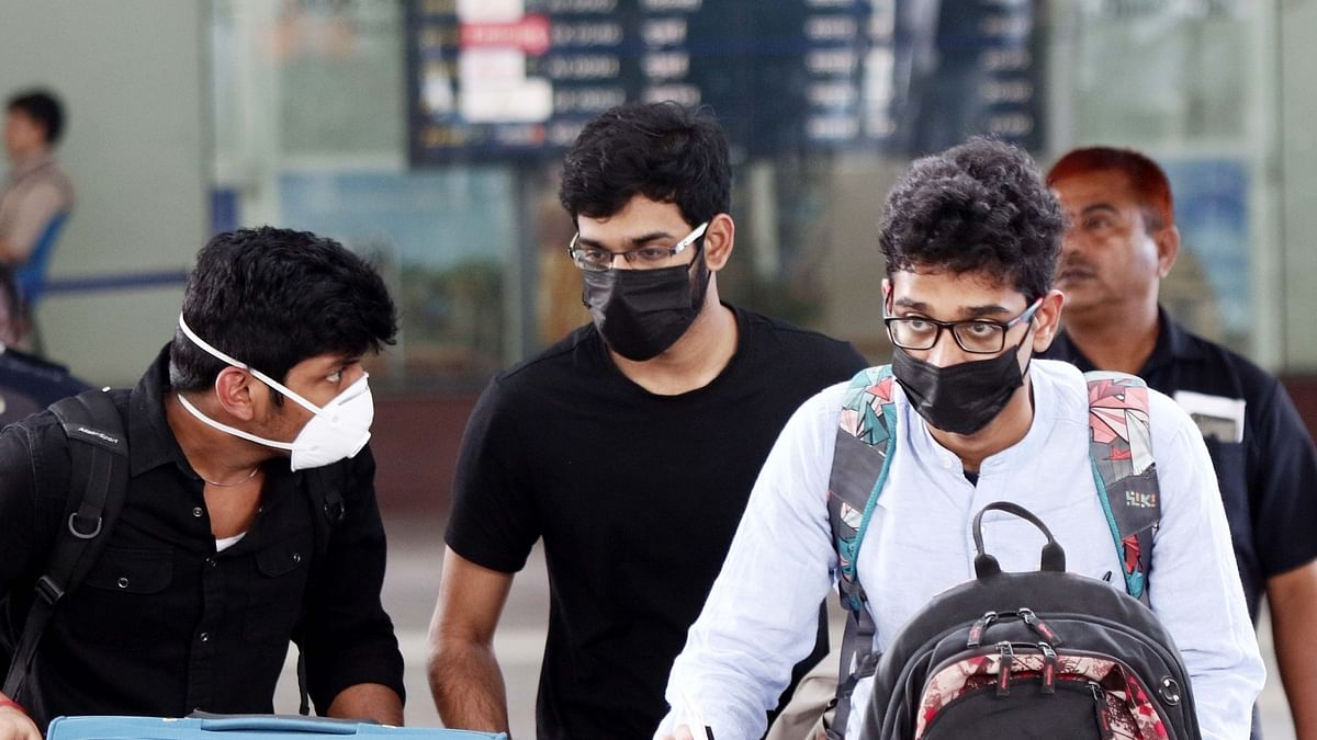 People wearing masks as a precautionary measure against the novel coronavirus outbreak; at Chennai International Airport on February 1, 2020.