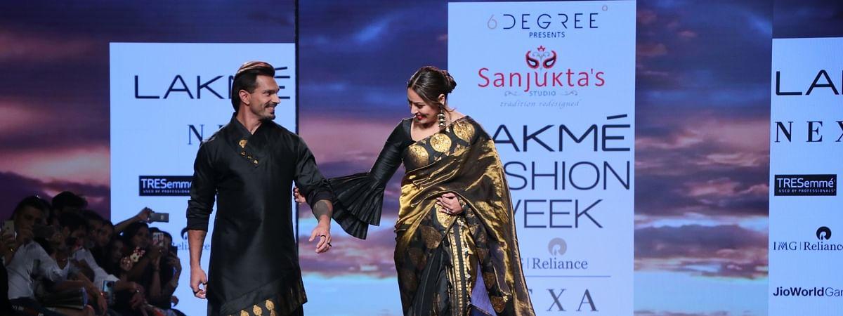 Actors Bipasha Basu and Karan Singh Grover walk the ramp at Lakme Fashion Week, in Mumbai on February 14, 2020.