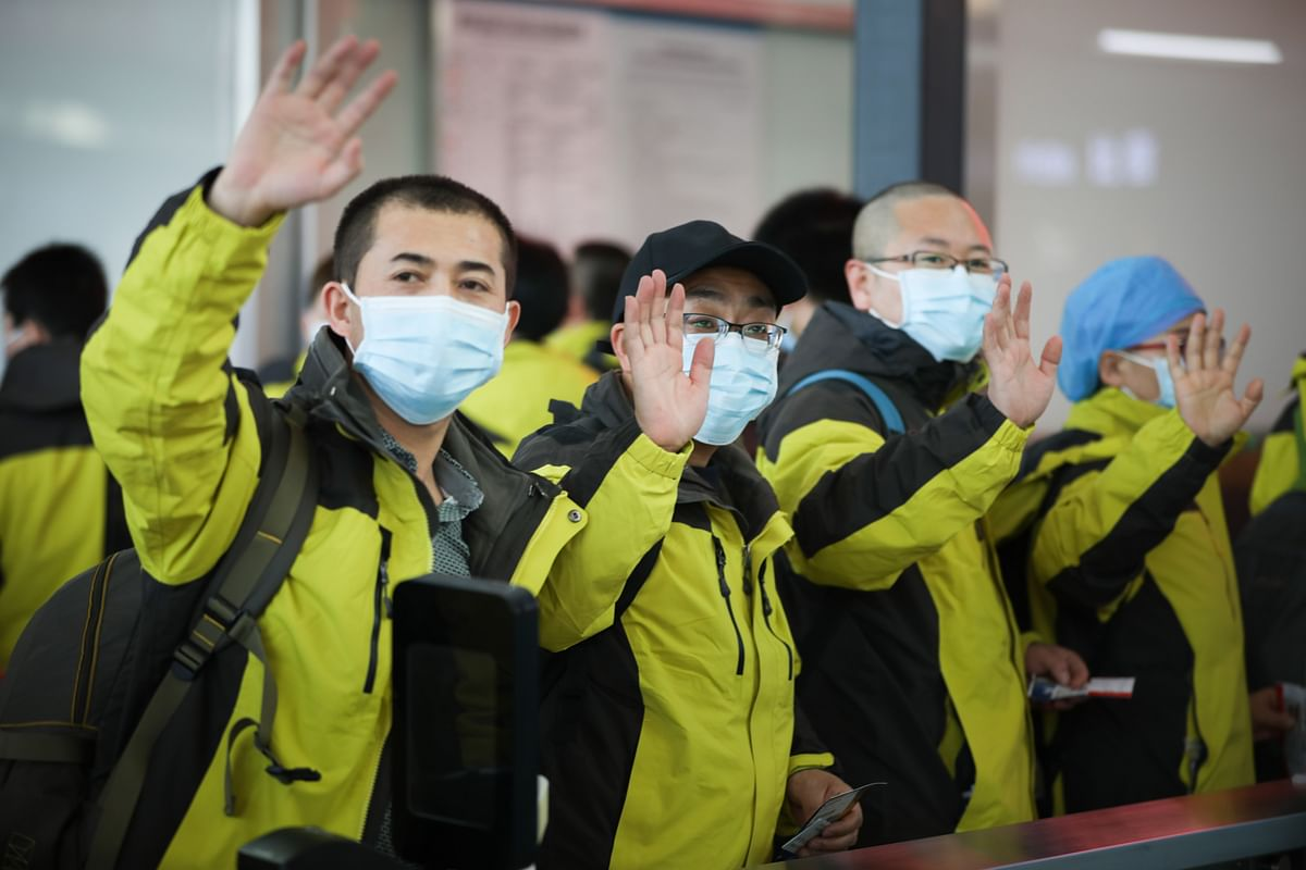 Members of a medical team leaving from Lanzhou in northwest China's Gansu province for Hubei, the epicentre of the novel coronavirus outbreak that has hit the country, on February 21, 2020.