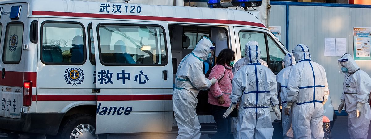 Medical staff receiving a patient infected with the novel coronavirus at a temporary in Wuhan, China on February 12, 2020.