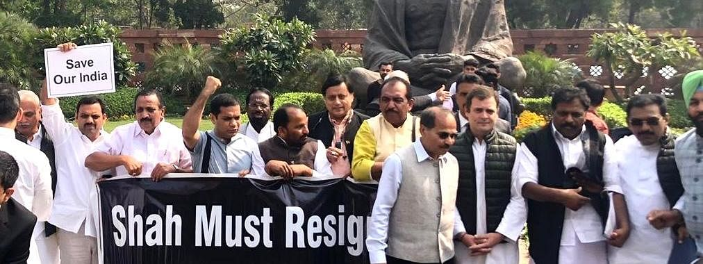 Congress MPs led by Rahul Gandhi, Adhir Ranjan Chowdhury and Shashi Tharoor staging a demonstration demanding Union Home Minister Amit Shah's resignation, in front of the statue of Mahatma Gandhi in Parliament House complex in New Delhi on March 2, 2020.