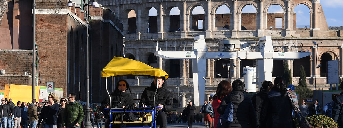 People walking near the Colosseum in Rome, Italy, on March 8, 2020.