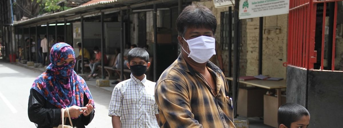 People wearingmasks as a precautionary measure against the COVID-19 or Coronavirus, in Mumbai on March 12, 2020.