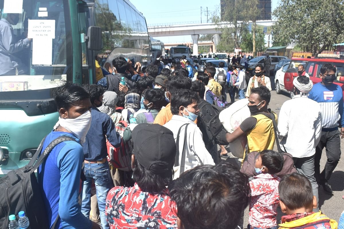 Migrant workers in large numbers seen at the Anand Vihar bus terminal close to Delhi's border with Uttar Pradesh on Day 5 of the 21-day countrywide lockdown imposed to contain the spread of novel coronavirus, on March 29, 2020.