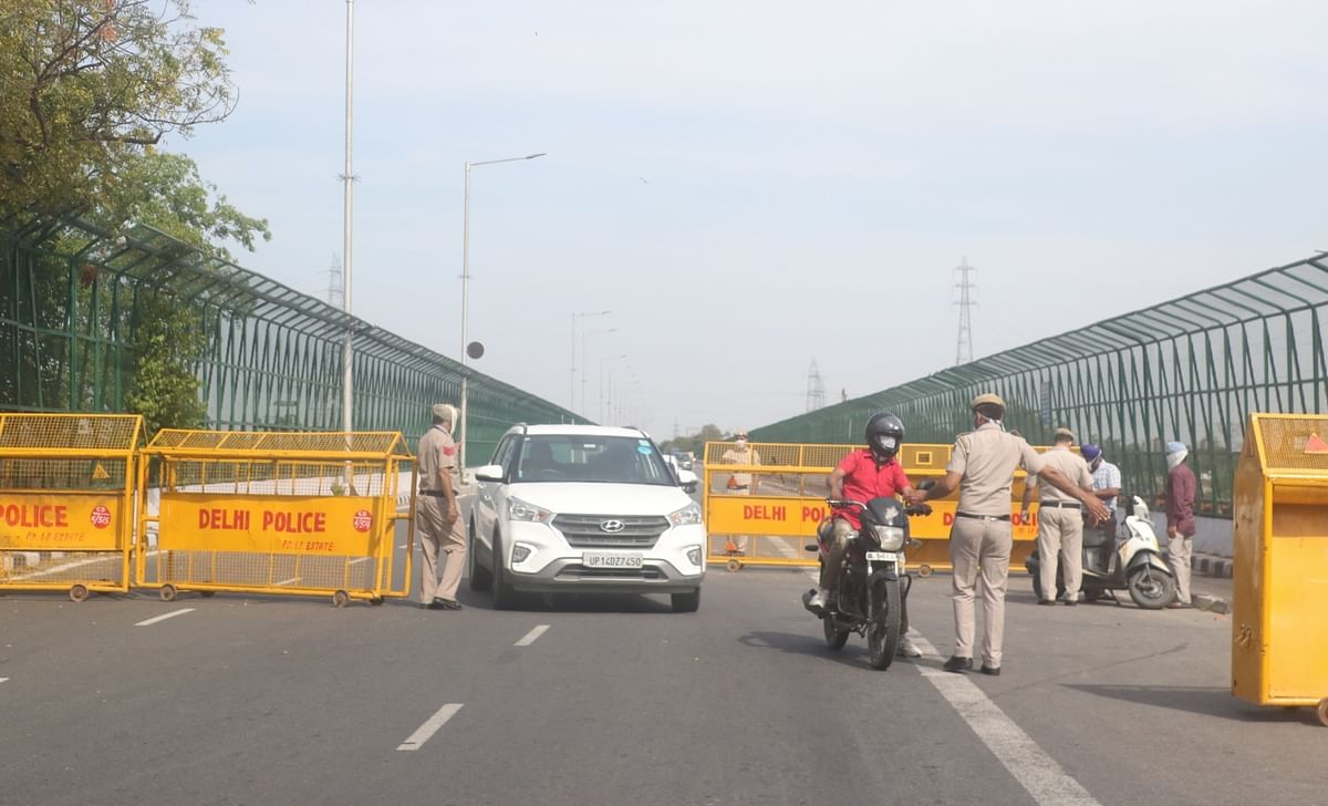Barricades placed and police personnel deployed at ITO Bridge over Yamuna river, during the 21-day long nationwide lockdown imposed to contain the spread of COVID-19 (coronavirus), in New Delhi on March 25, 2020.