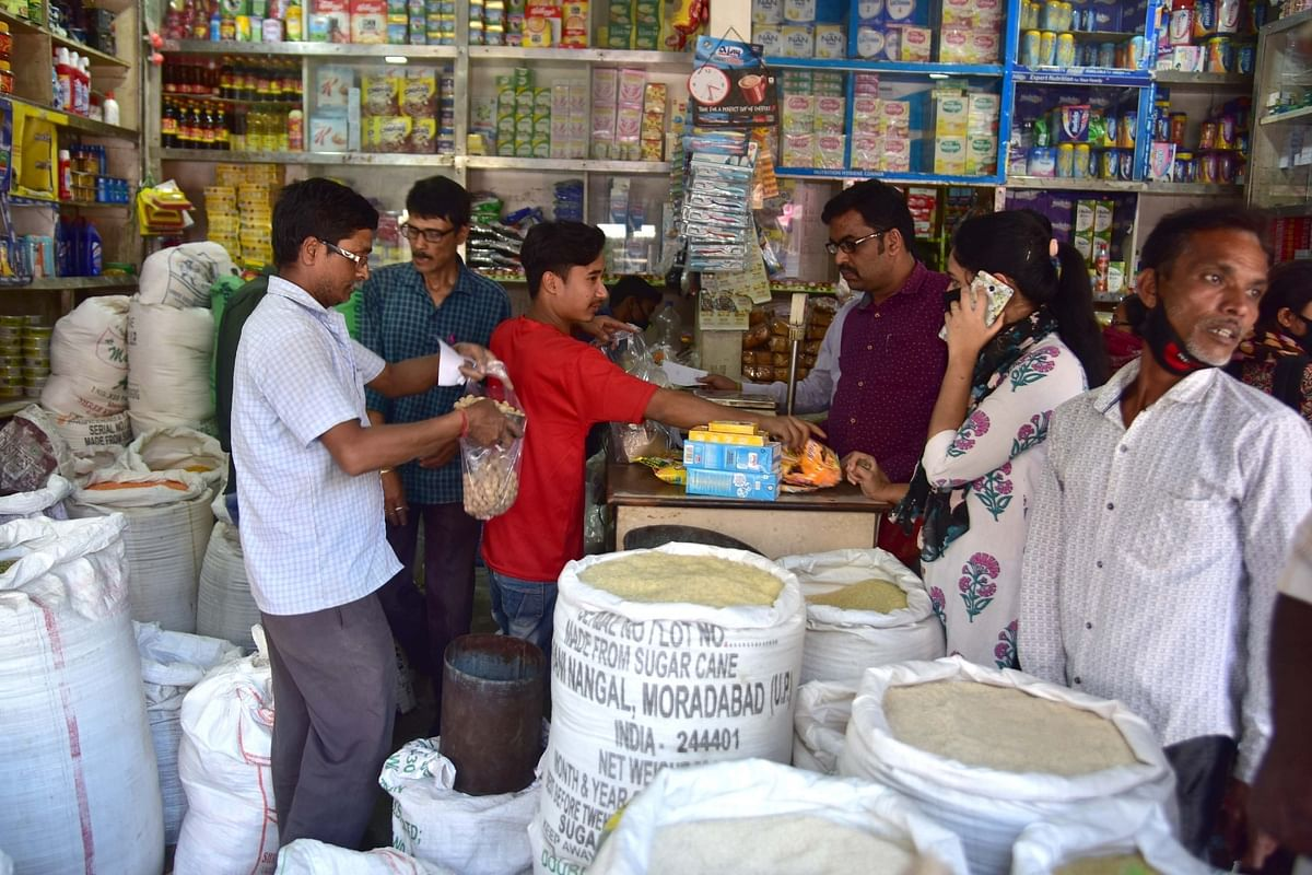 People buying essential items at a general store in Nagaon, Assam, during the complete lockdown imposed in the country as a precautionary measure to contain the spread of the coronavirus, on March 24, 2020.