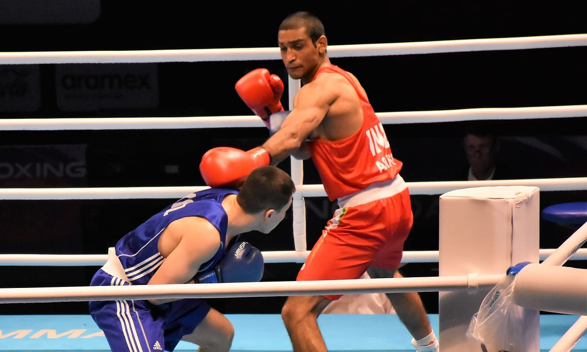 India's Ashish Kumar in action against Bekzhigit Uulu Omurbek of Kyrgyzstan at the Asian/Oceanian Olympic Qualifiers in Amman, Jordan on March 5, 2020.