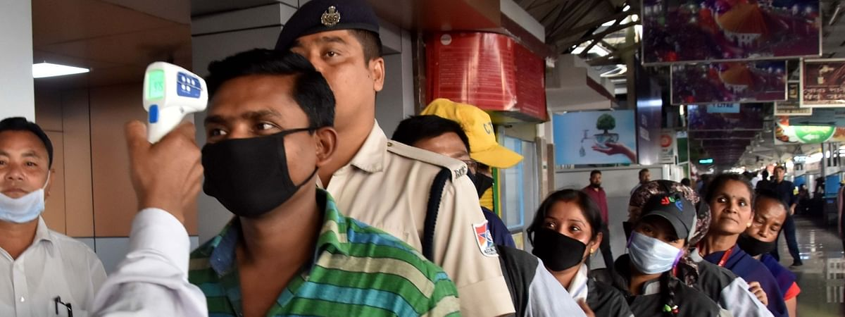 Thermal screening of passengers being conducted at the Guwahati Railway Station in Assam, as part of measures to prevent the spread of novel coronavirus, on March 16, 2020.