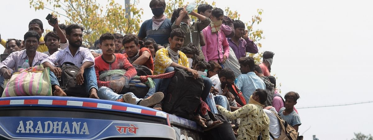 An overcrowded bus with migrant workers returning home amid COVID-19 outbreak, seen during complete lockdown in the country in a bid to curtail the spread of coronavirus, in Kolkata on March 23, 2020.
