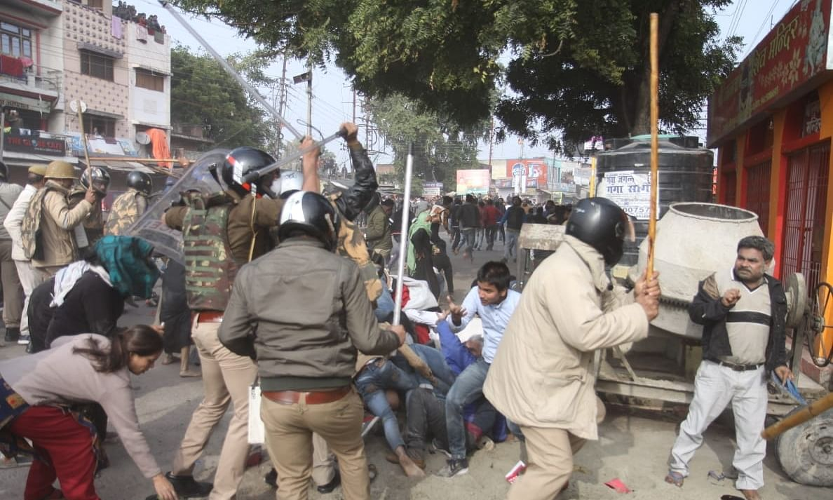 Police baton-charging protesters to disperse them during a demonstration against the Citizenship Amendment Act (CAA) 2019, in Lucknow on December 19, 2019.
