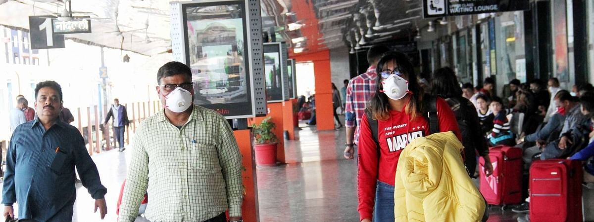 Passengers wearing masks as a precautionary measure against coronavirus, at the New Delhi Railway Station in Delhi, on March 18, 2020.