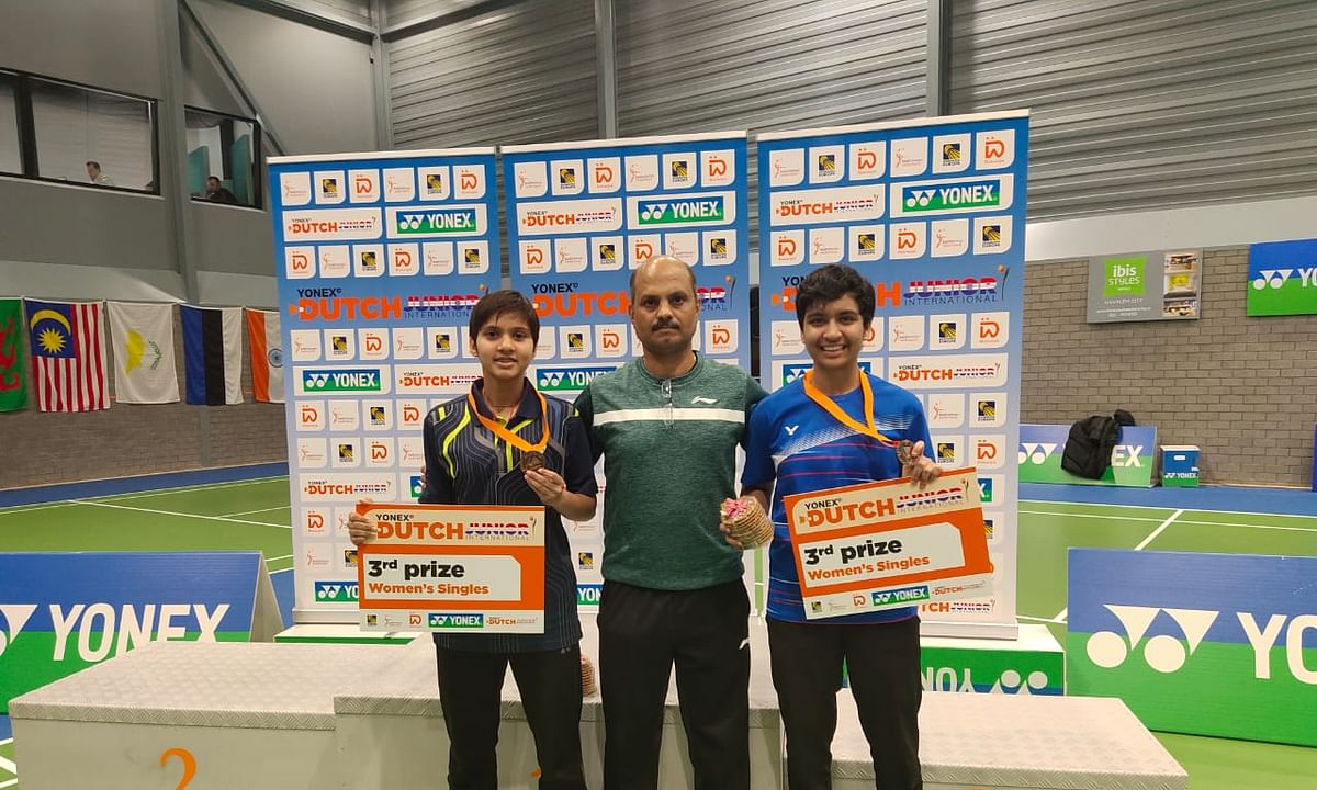 Mansi Singh and Tasnim Mir with coach Sanjay Mishra after they won bronze medals at the Dutch Junior International Badminton Tournament.