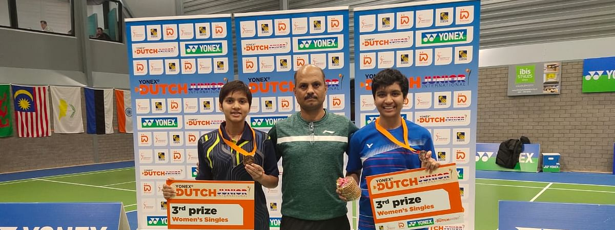 Mansi Singh and Tasnim Mir with coach Sanjay Mishra after they won bronze medals at the Dutch Junior International Badminton Tournament.