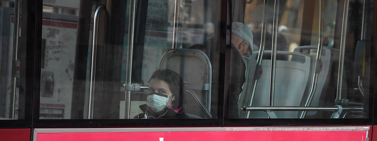 A girl wearing a facial mask is seen on a bus in Rome, Italy, March 8, 2020.