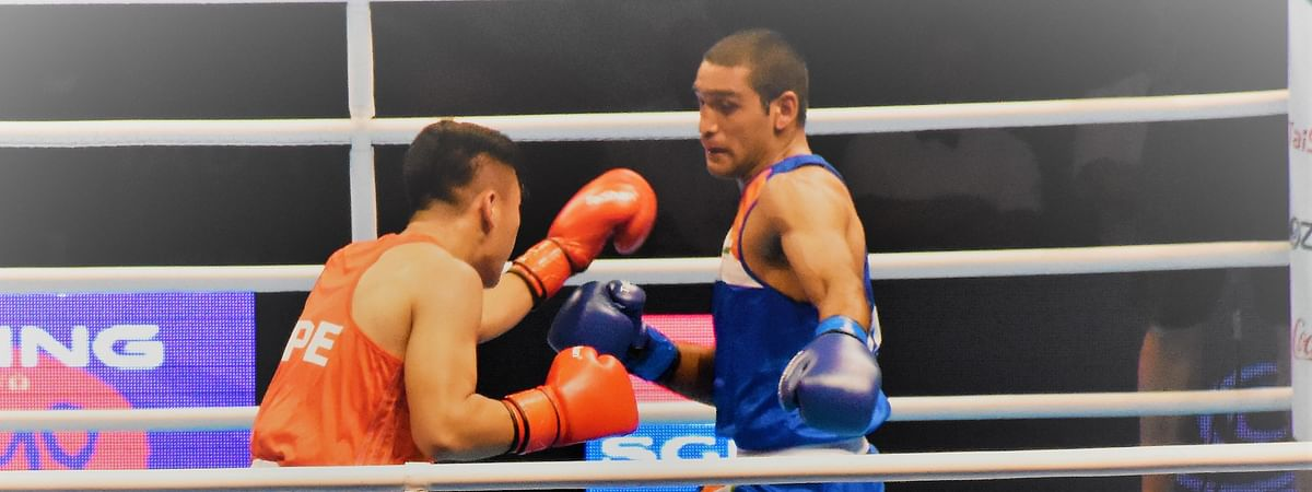 India's Ashish Kumar on way to victory against Kan Chia-Wei of Chinese Taipei to reach the quarter-finals of the Asian/Oceanian Olympic Qualifiers in Amman, Jordan on March 3, 2020.