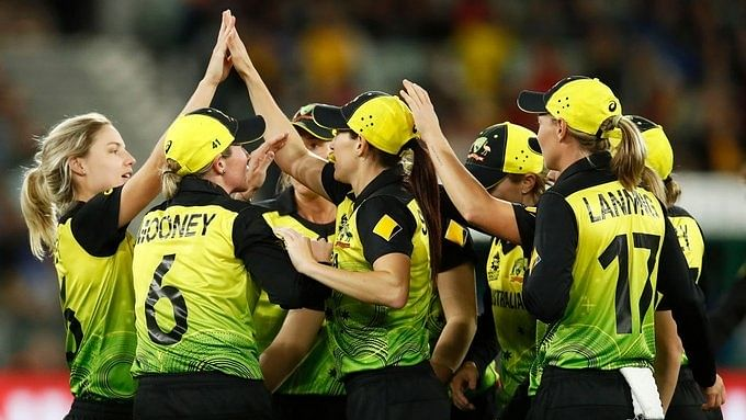 Australian players celebrate after beating India and winning the  women's T20 World Cup title at Melbourne Cricket Ground in Melbourne, Australia on March 8, 2020.