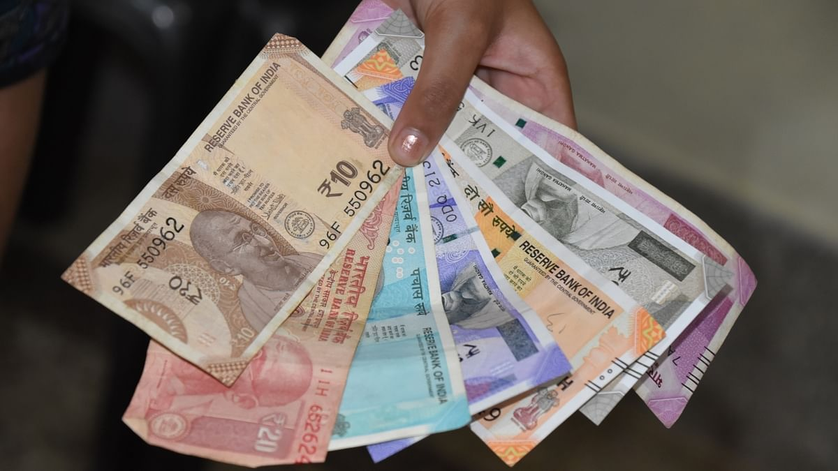 Rupee hits new low of 76.91 a dollar
