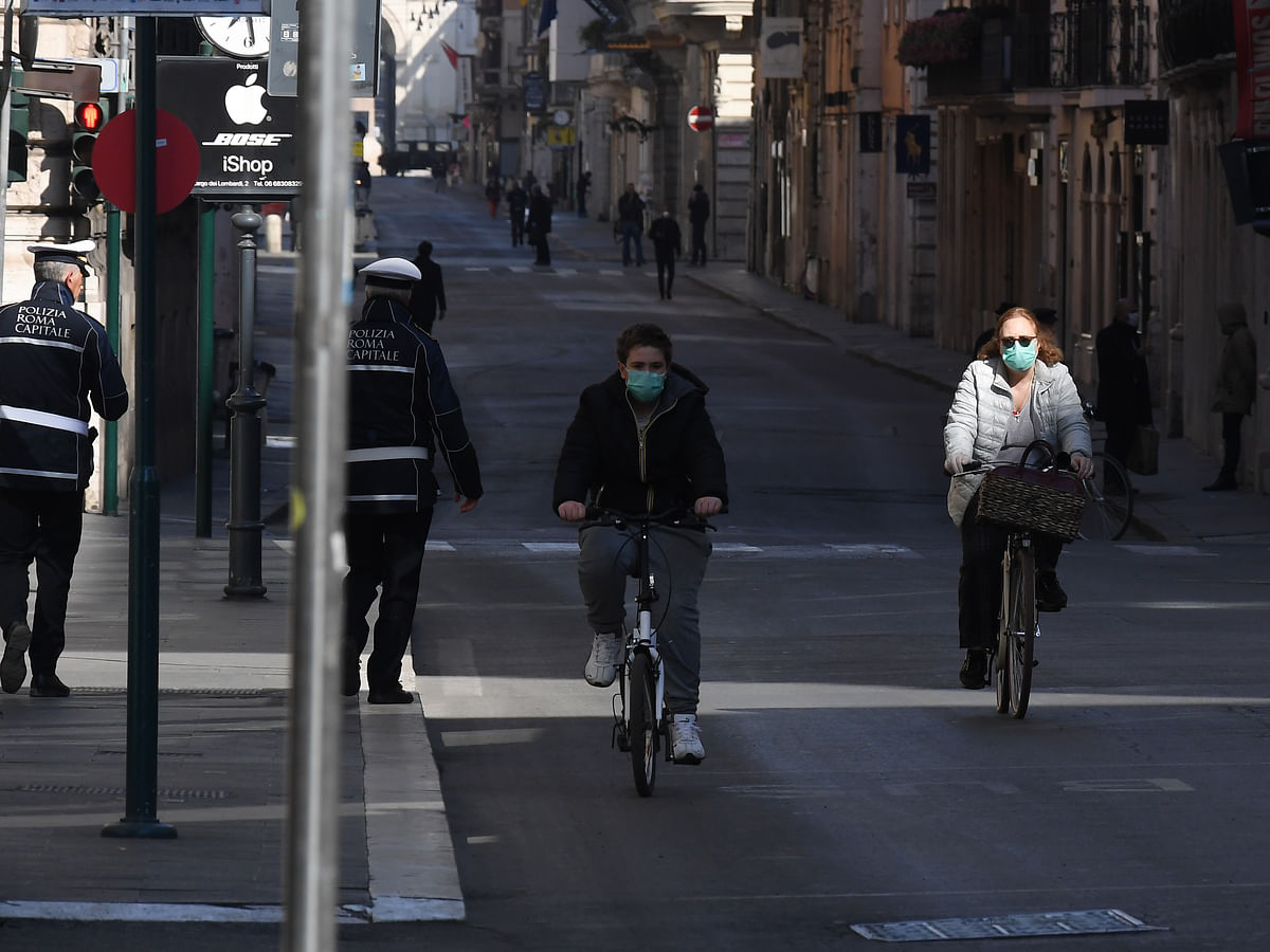 People wearing face masks in Rome, Italy on March 18, 2020 as the number of deaths due to coronavirus continued to increase.
