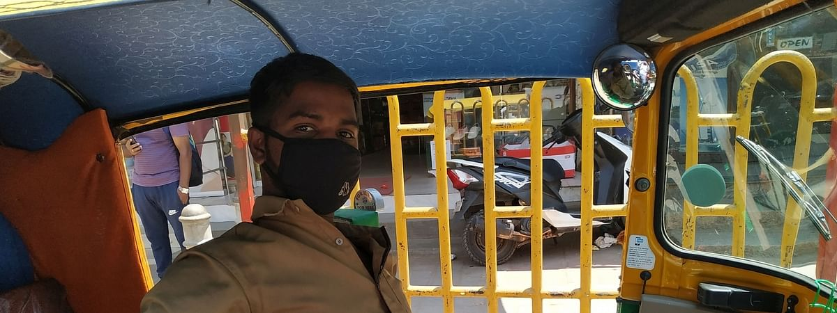 An autorickshaw driver wearing a protective mask against the coronavirus, in Bengaluru on March 14, 2020.