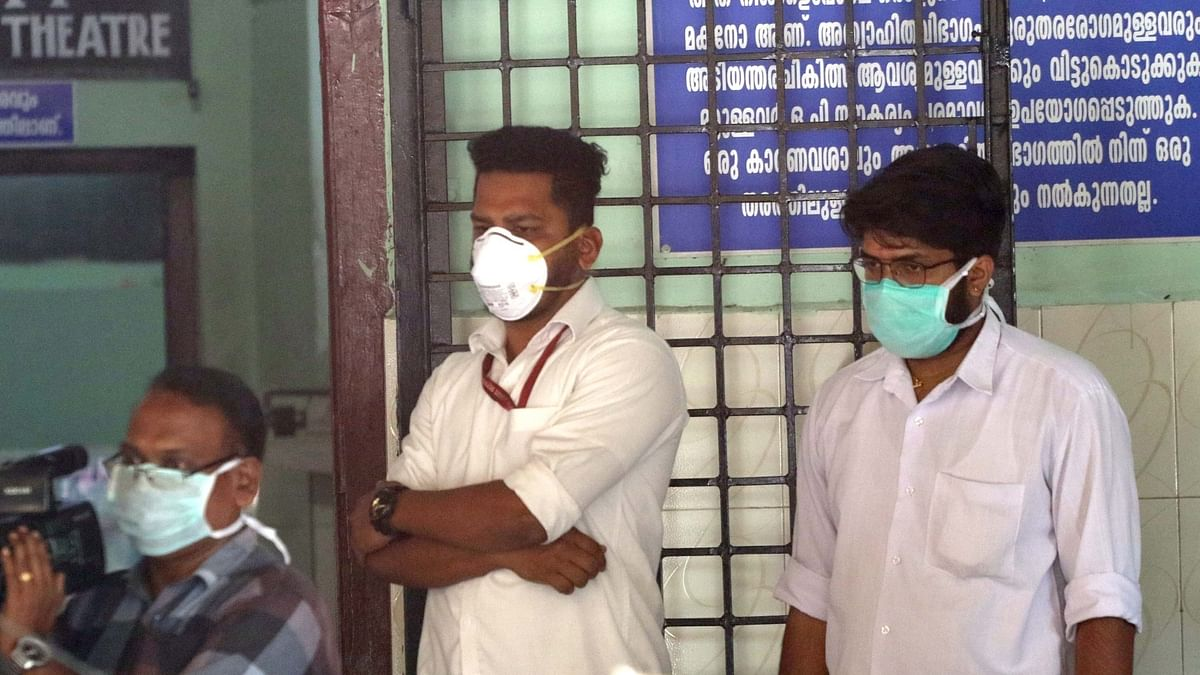 File photo of people wearing masks as a precaution against the coronavirus outside a hospital in Thrissur, Kerala.