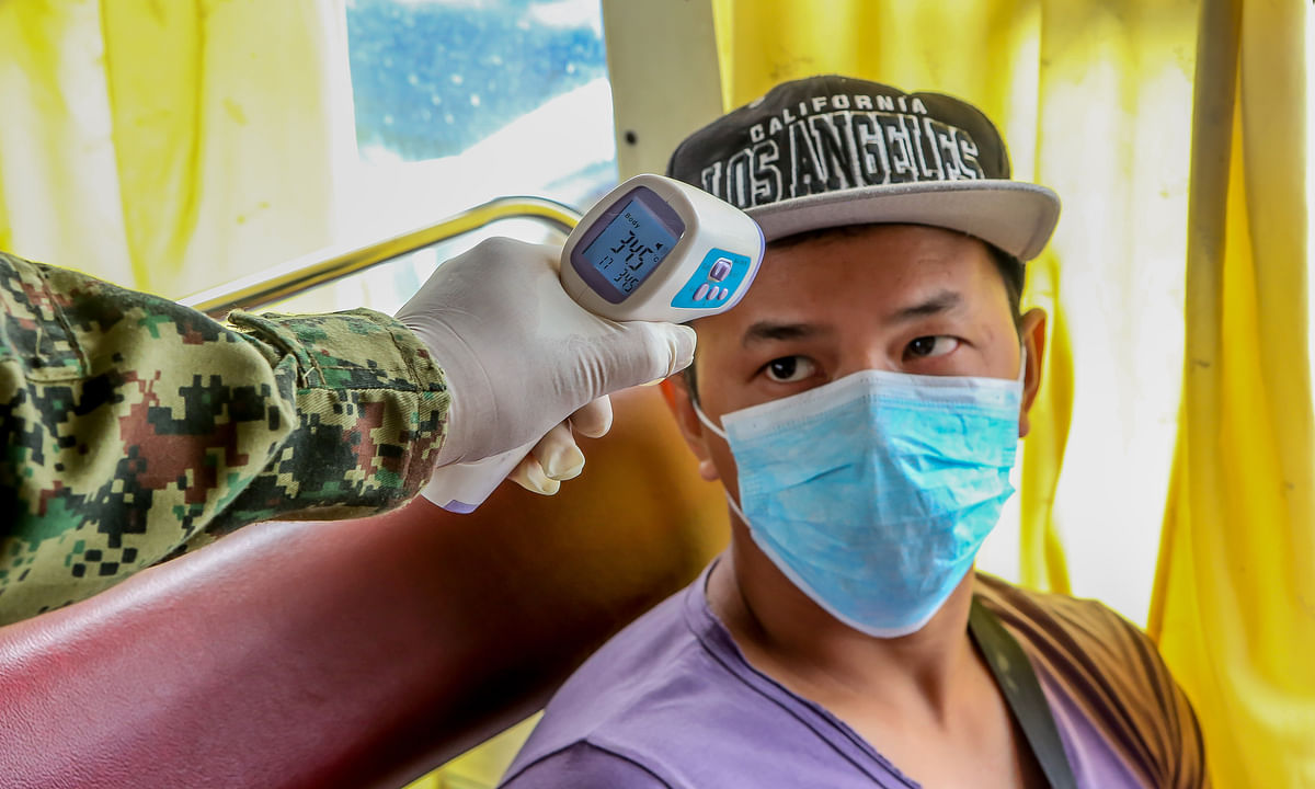 A cured coronavirus patient being discharged from a hospital in Guiyang, southwest China's Guizhou Province, on March 16, 2020.