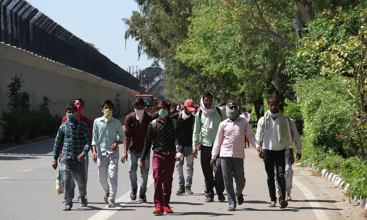 File photo of migrant workers heading for home on foot, in Delhi on March 28, 2020
