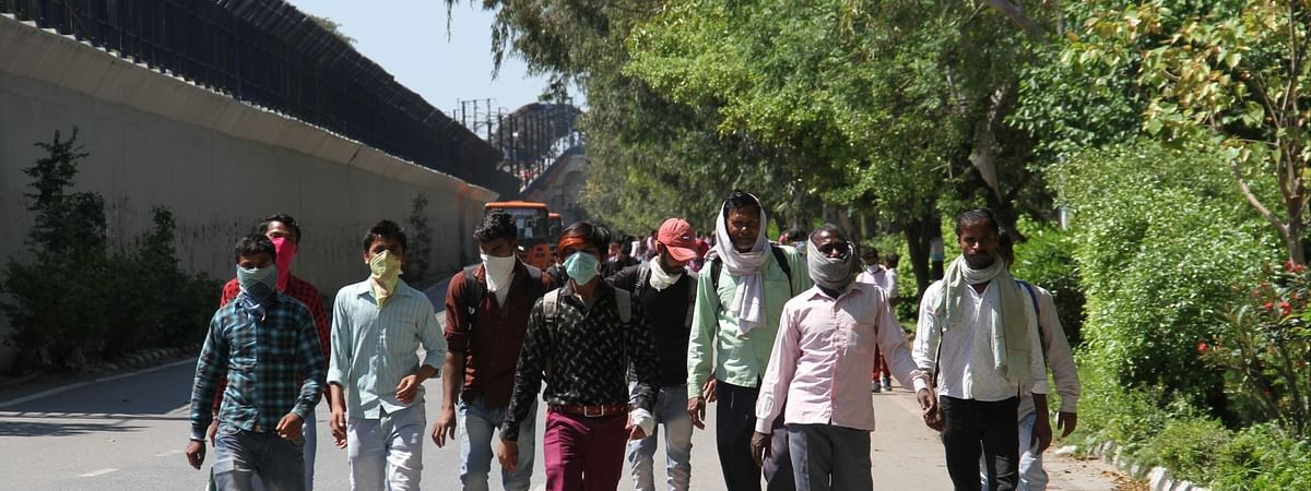Migrant workers heading for home on foot, in Delhi on March 28, 2020