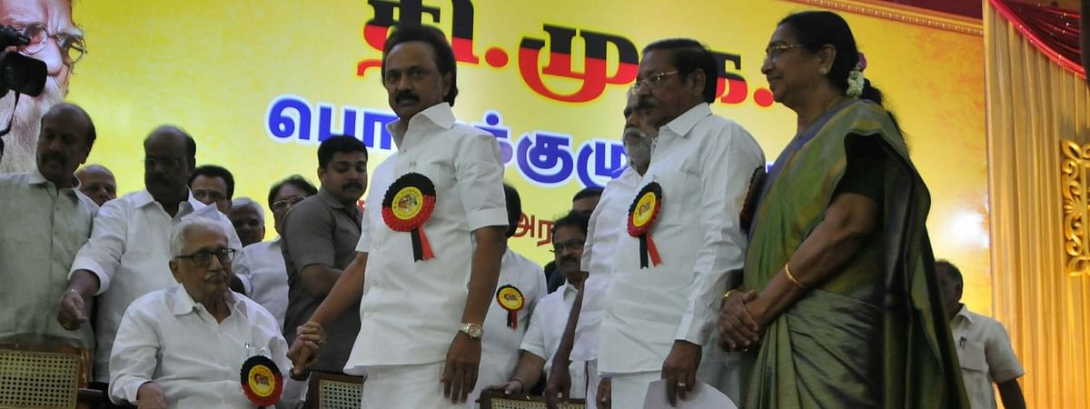 File photo of DMK General Secretary K. Anbazhagan (seated) greeting M. K. Stalin on his election as the DMK President, in Chennai, on August 28, 2018.