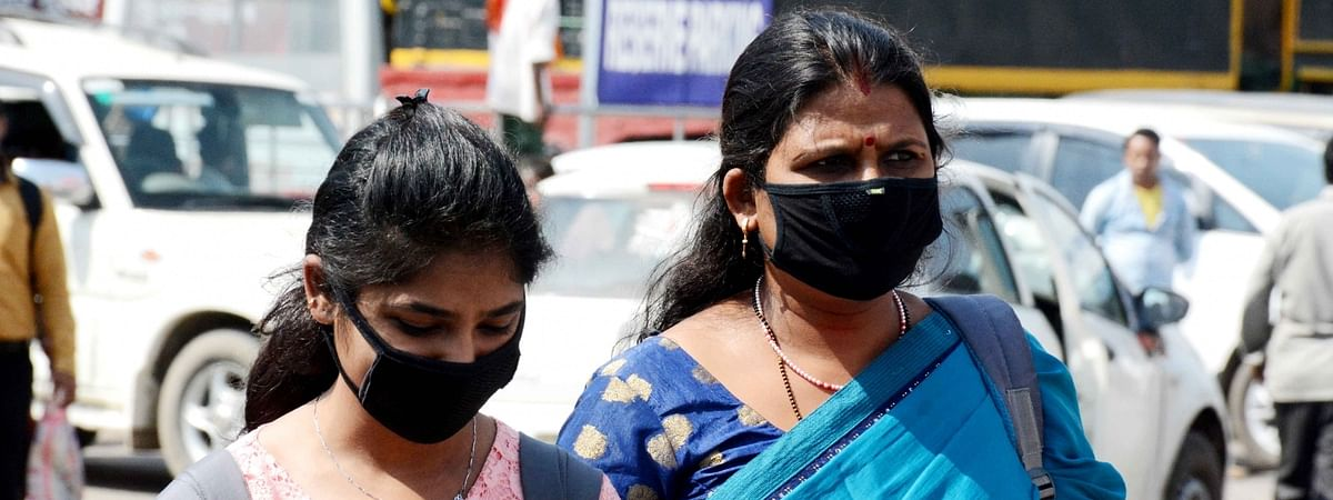 People wearing masks as a precautionary measure against coronavirus (COVID-19), in Patna, Bihar on March 20, 2020.