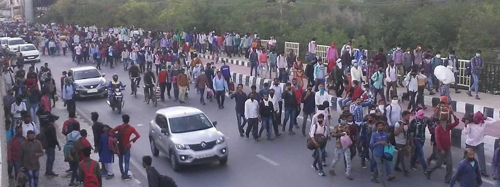 Migrant workers walking to their homes in Uttar Pradesh as the nationwide lockdown imposed from Wednesday has left them without income, food and shelter, on the Delhi-Uttar Pradesh border, on March 27, 2020.