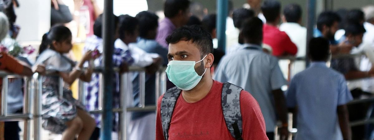 File photo of people wearing masks as a precautionary measure against the novel coronavirus, at Chennai International Airport on February 1, 2020.