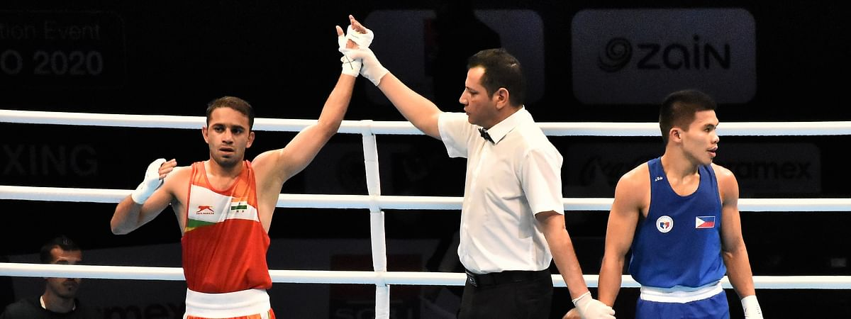 India's Amit Panghal (52kg) after defeating Carlo Paalam of The Philippines 4-1 to move into the semi-finals of the Asian/Oceanian Olympic Qualifiers in Amman, Jordan on March 9, 2020.