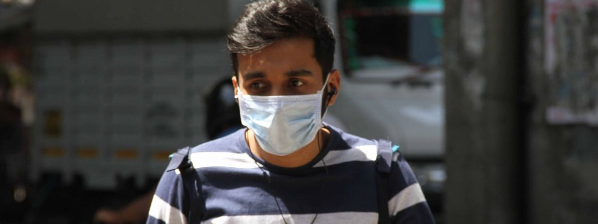 A person wearing a mask as a precautionary measure against the COVID-19 or Coronavirus, in Mumbai on March 12, 2020.
