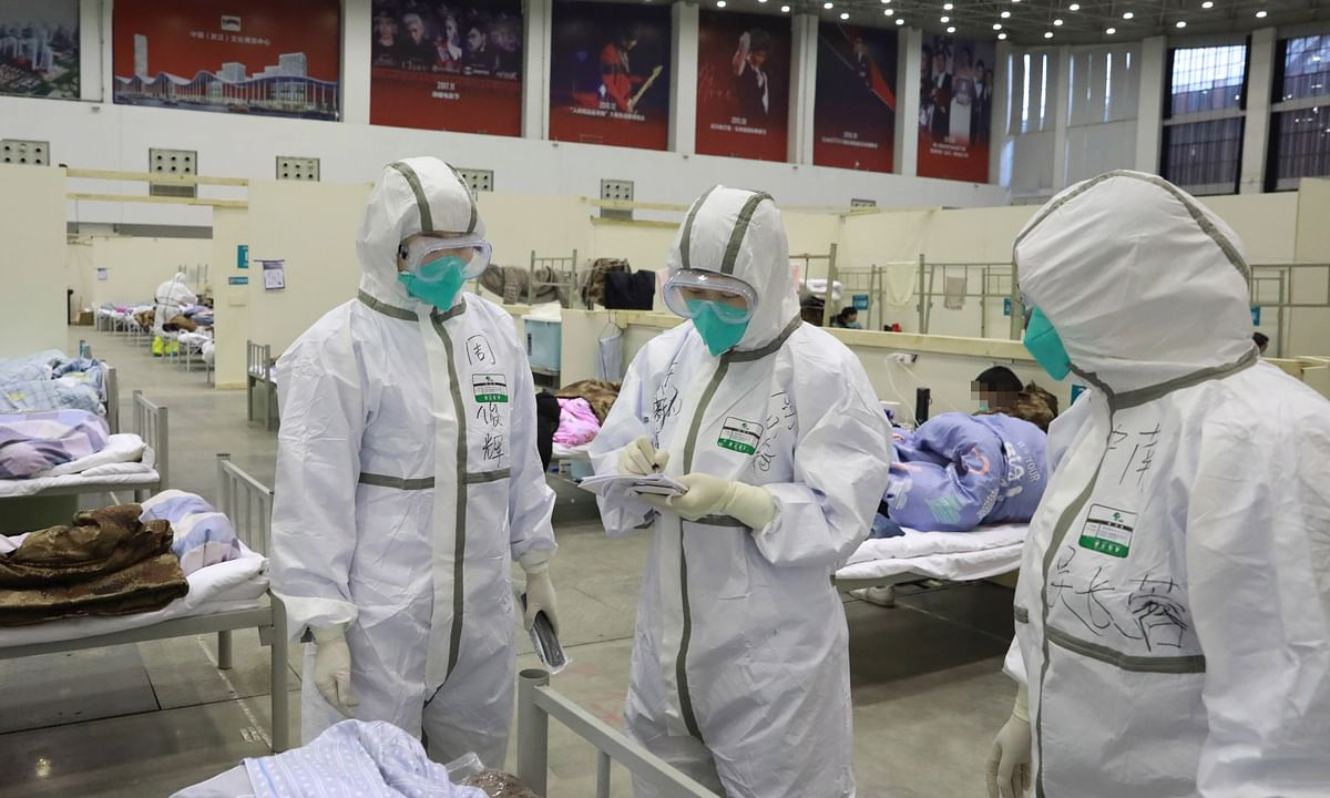 File photo of medical workers at a temporary hospital in Wuhan in China's Hubei province.