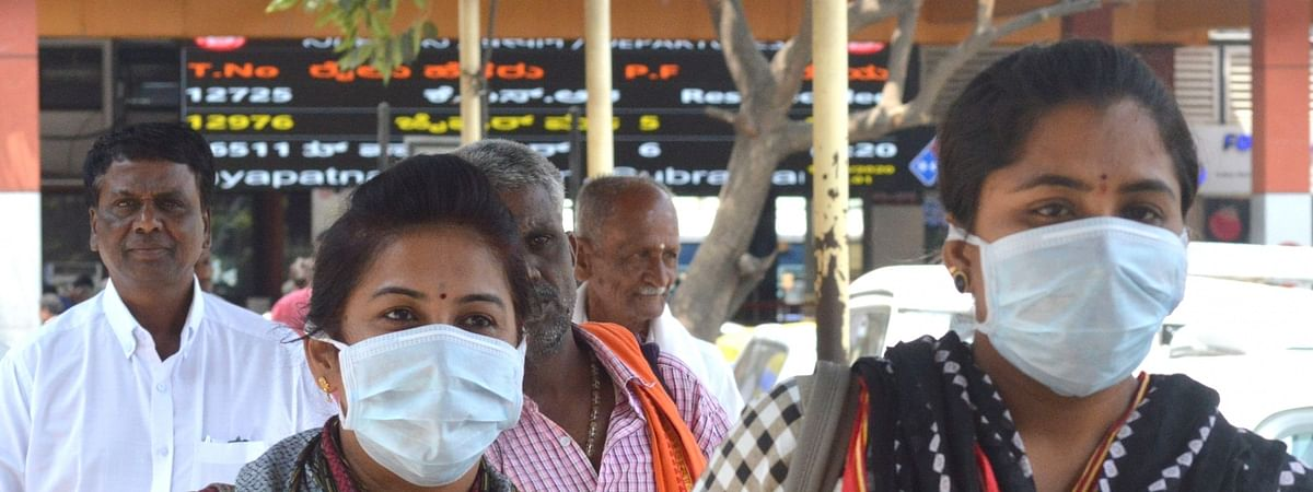 People wearing masks at Bengaluru City Railway Station as a precautionary measure against coronavirus, in Bengaluru on March 11, 2020.