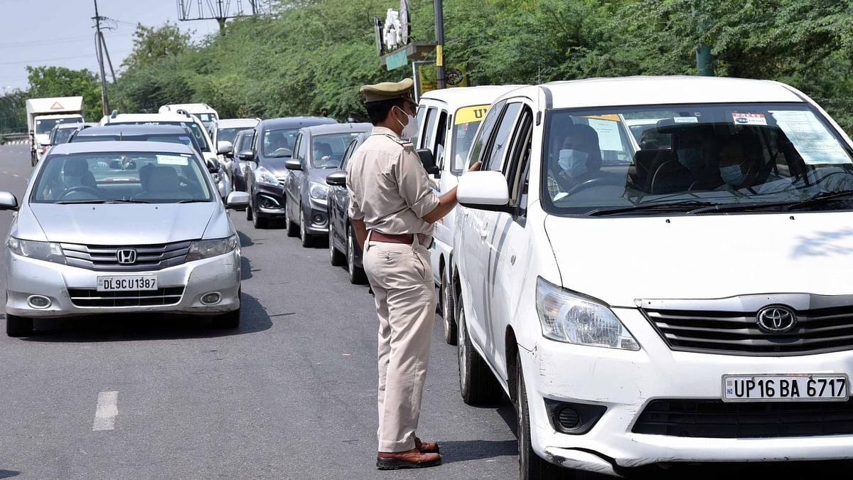 Police conducting checks on vehicles at the Delhi-Noida border during the extended nationwide lockdown imposed to mitigate the spread of coronavirus; on April 21, 2020.