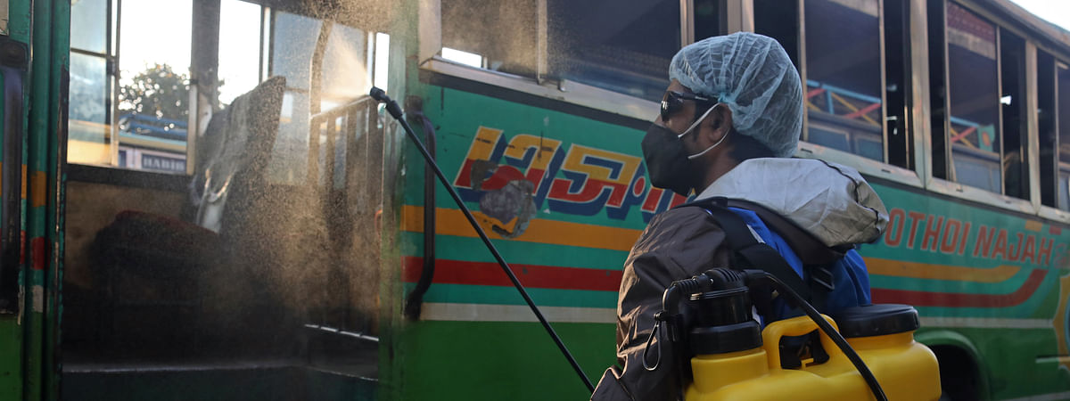 A worker sterilizing a bus in Dhaka, Bangladesh, on March 19, 2020.