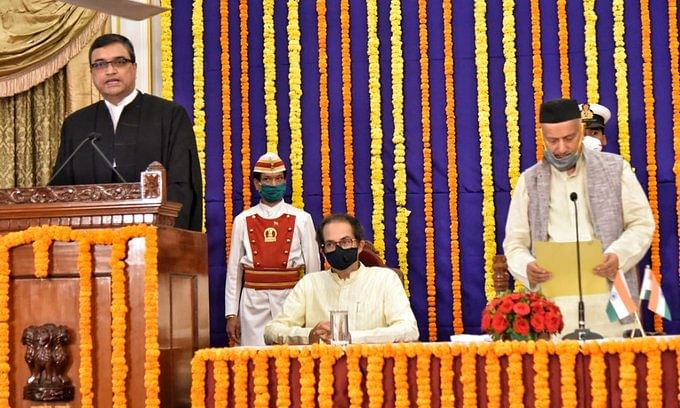 Justice Dipankar Datta being sworn in as the new Chief Justice of Bombay High Court by Maharashtra Governor Bhagat Singh  Koshyari, in Mumbai on April 28, 2020. Chief Minister Uddhav Thackeray is also seen.