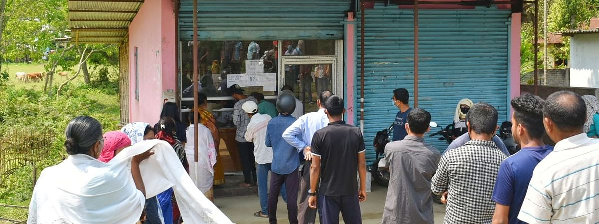 People buying essential items at a general store during the nationwide lockdown to contain  the spread of the coronavirus, in Nagaon, Assam on March 24, 2020.