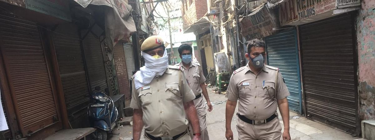 Policemen enforcing the lockdown to contain the coronavirus pandemic, in Old Delhi on April 26, 2020.