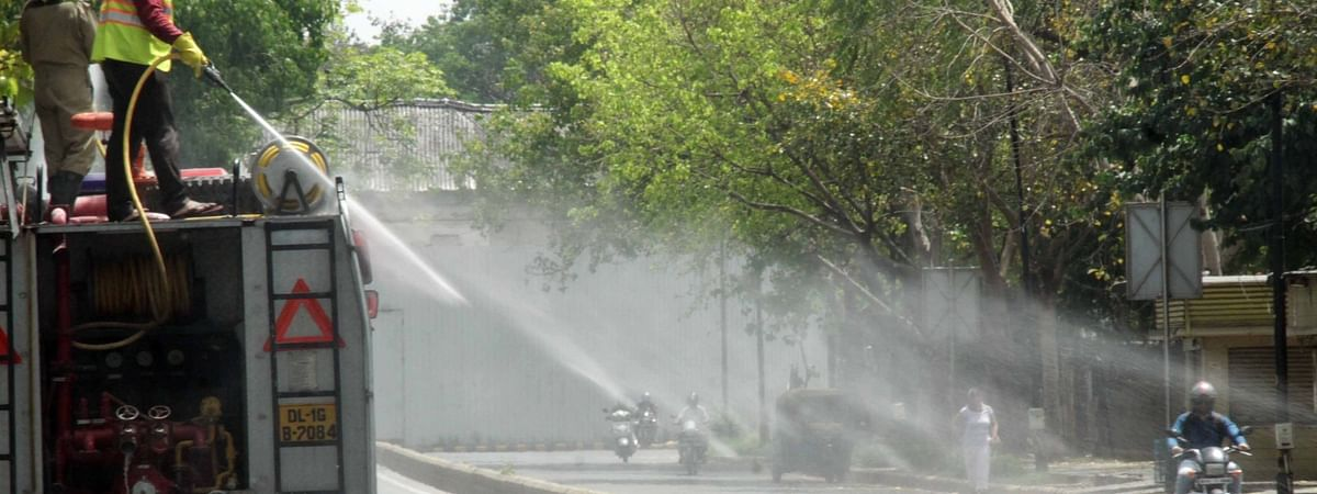 NDMC firefighters spraying disinfectants in a residential area during the nationwide lockdown imposed to contain the spread of the COVID-19 pandemic, in New Delhi on April 15, 2020.