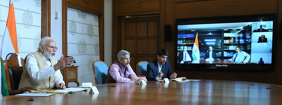 Prime Minister Narendra Modi interacting with the Heads of Indian Missions abroad through video conferencing to discuss responses to the global COVID-19 pandemic, in New Delhi on March 30, 2020. External Affairs Minister S Jaishankar is also seen.