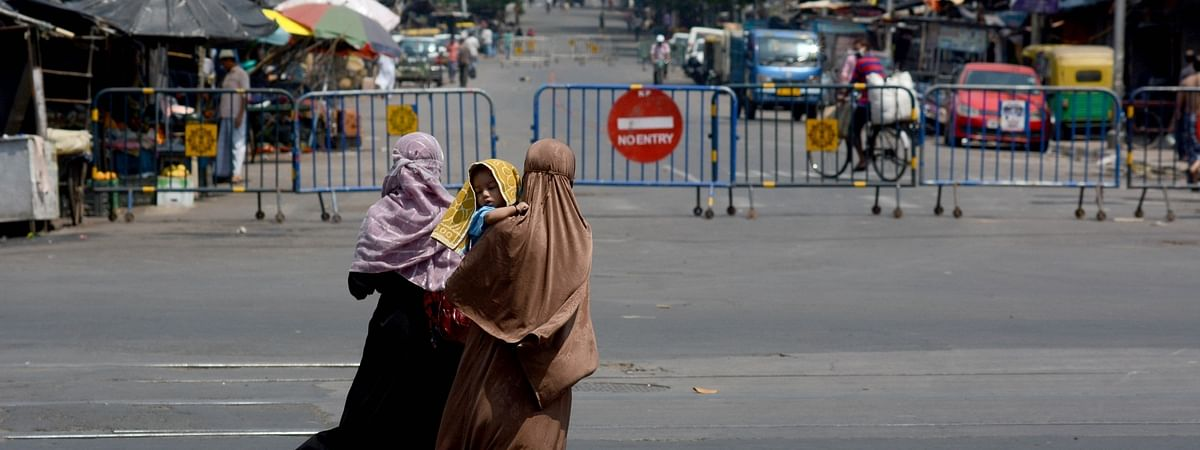 Barricades put up at the entrance of Kolkata's Narkel Danga locality that has been sealed during the extended nationwide lockdown imposed to mitigate the spread of coronavirus, on April 17, 2020.
