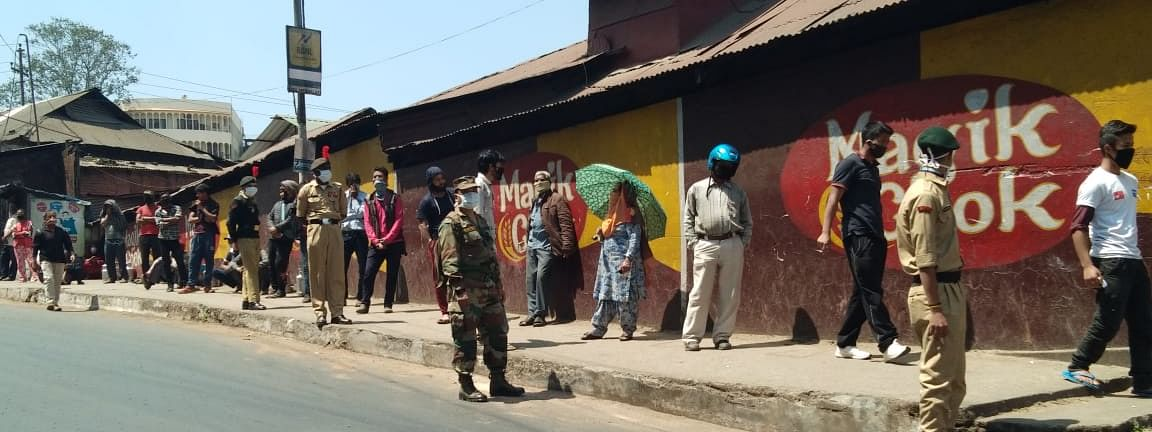 NCC cadets deployed to help ensure physical distancing during distribution of rations at government-approved shops, in Shillong, Meghalaya on April 6, 2020.