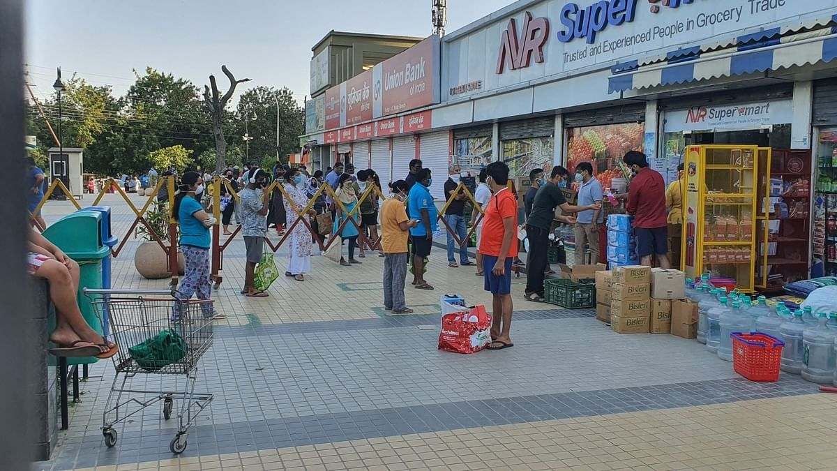 People queueing up to stock up on food, medicines and other essential items in Noida, Uttar Pradesh after the state government's decision to firmly implement the lockdown and completely seal 'hotspots' in 15 districts, on April 8, 2020.