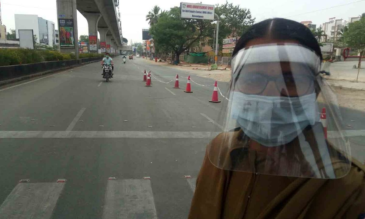 A lady constable on duty wears a special protective mask during the  lockdown imposed to contain the spread of COVID-19, in Hyderabad on April 6, 2020.