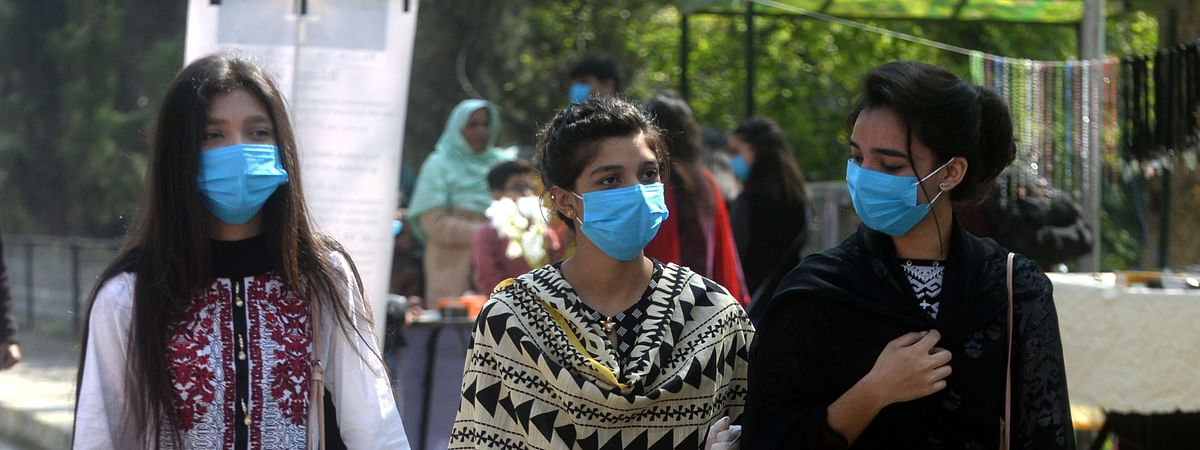 Passengers wearing face masks are seen at a railway station in  Karachi, Pakistan on March 15, 2020.