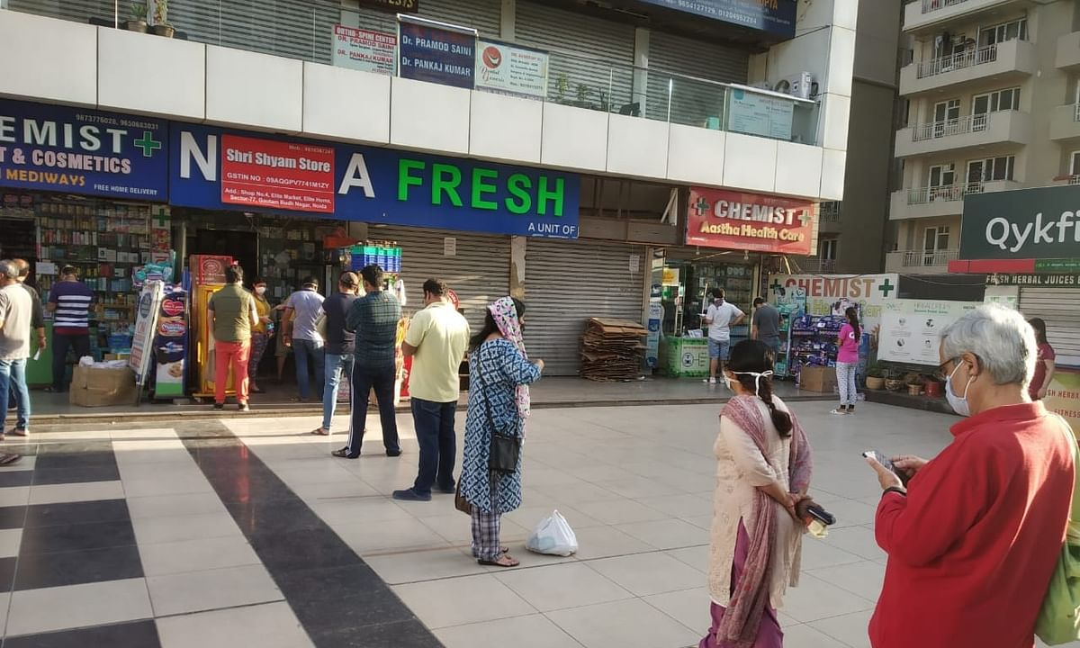People queueing up outside a grocery store in Noida, near Delhi, to stock up on essential items, on April 8, 2020.