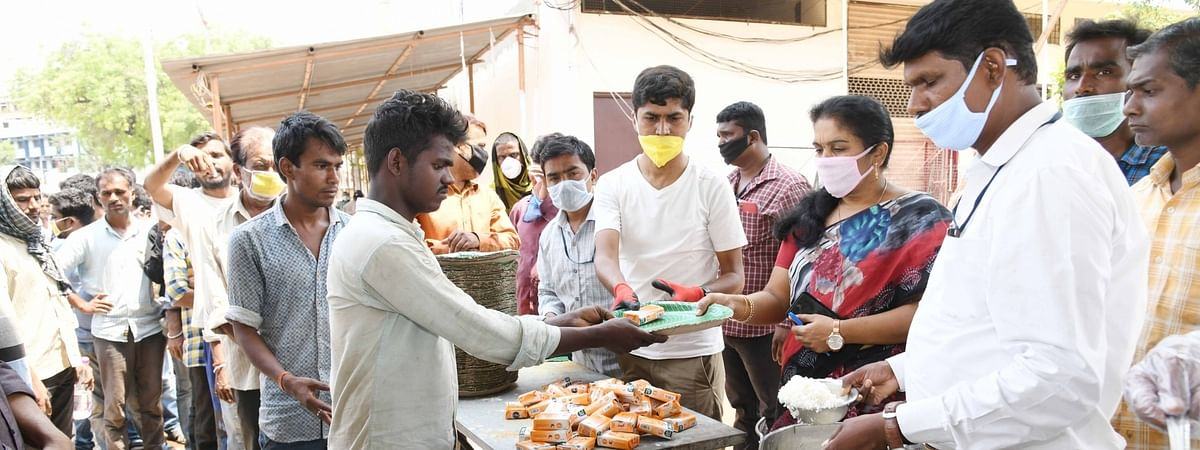 Food being distributed among the poor by the Greater Hyderabad Municipal Cororatuon at a camp on the eighth day of the 21-day nationwide lockdown imposed tp contain the spread of coronavirus, in Hyderabad on April 1, 2020.