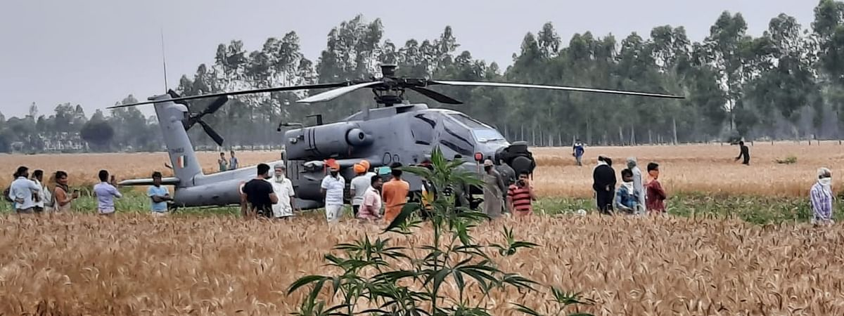 """An Apache helicopter of the Indian Air Force which made a """"precautionary"""" landing in a field in Hoshiarpur district of Punjab after the pilot noticed a technical glitch, on April 17, 2020."""